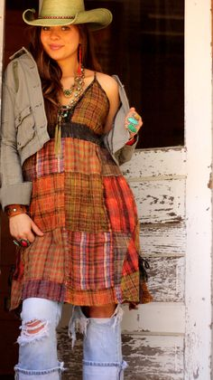 I'm not a cowgirl, nor is this my fashion style, but anyone who can put multiple plaids together has a place in my happy book.  Yee-ha!