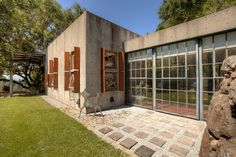 Painter and sculptor John Holmes and his wife Kathleen are the owners of this one-bedroom house in Penngrove, Calif., in Sonoma County. The couple purchased the parcel in 1986 for according to public records. Industrial Windows, Industrial House, Industrial Style, Cinder Block House, One Bedroom House, Retreat House, Furniture Factory, Backyard, Patio