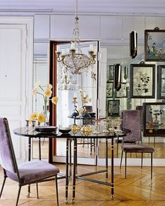 ...mirrored wall with secret door, lavender velvet chairs, gorgeous chandelier...and fabulous chevron floors...swooning over this space.