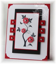handmade card ... card design from Our Creative Corner Sketch ... black, white and red ... like the way the layout frames the focal point ... silver brads for punched flower cents and the strips of color crossing behind the top layer ... great card!!