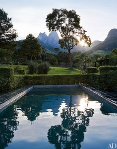 The swimming pool reflects the towering Três Picos mountains | archdigest.com