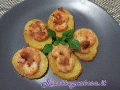 Gamberi e patate gratinati al forno..  http://www.ricettegustose.it/Secondi_di_pesce_1_html/Gamberi_e_patate_gratinati_al_forno.html
