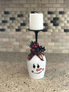 Cute Christmas snowman wine glass candle holder! Hand painted. This is made to order so design may vary slightly. Measures 9 without candle and 12 with candle.