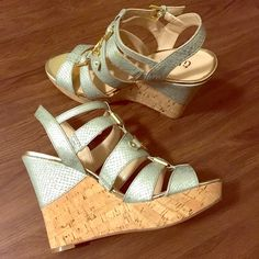Sea green platform heels Pretty sea green with a snake skin pattern and gold colored buckles. Tall, but very comfortable. Worn 2-3 times, excellent condition aside from very minor wear on the soles. True to size. Guess Shoes Platforms