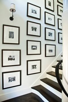 In the stair hall, we hung the client's collection of Christmas cards. We reprinted them in black and white and framed them in black frames, so they make both a graphic statement and also tell a fun story.  mrshoward