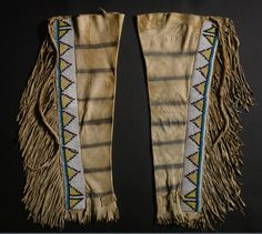 Blackfoot leggings, a pair of leggings, painted with a series of black stripes, overlaid with beaded strips.