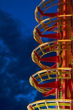 A carnival ride at dusk