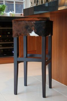 A fabulous cowhide bar stool ideally suited to either a modern or traditional