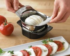Tomato/Mozzarella Slicer: This useful tool swiftly cuts ripe tomatoes and creamy mozzarella into uniform slices.