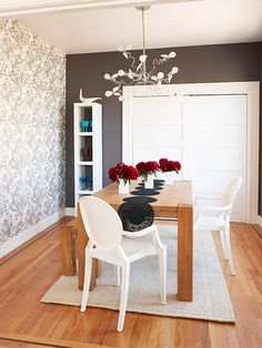 Gray dining room with wallpaper accent wall, love the light fixture and table runner also