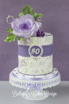 Lilac vintage cake with a wafer paper rose - This is a cake I made yesterday for a lady who turned 80. It's a doublebarrel cake filled with raspberry cream and marmalade. xxx Riany
