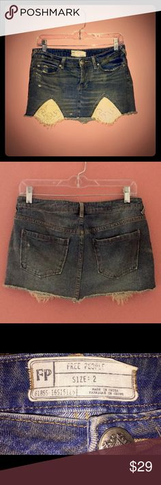 Free People Tire Swing Embroidered Denim Skirt 2R Free People rugged ripped denim handkerchief hem skirt in tire swing wash.  It has a classic 5-pocket styling with a button fly.  Excellent condition, worn only once. Free People Skirts Mini
