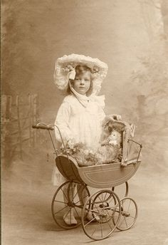 Victorian child with baby buggy