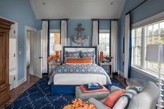 High contrast makes a stunning visual impact without sacrificing harmony.Blue and orange hues, opposites on the color wheel, are repeated in the wool rug and bedding in HGTV Dream Home 2015's nautical-inspired guest bedroom.