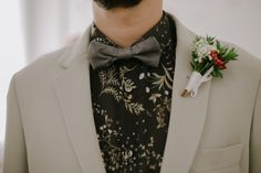 modern groom green and floral pattern suit boutonnière white purple and green.  wedding boho. unconventional wedding.