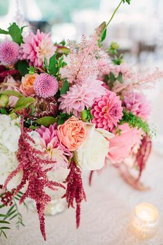 fuchsia centerpiece, photo by Brooke Courtney Photography http://ruffledblog.com/sophisticated-wedding-at-moonstone-manor #dahlias #centerpieces #flowers