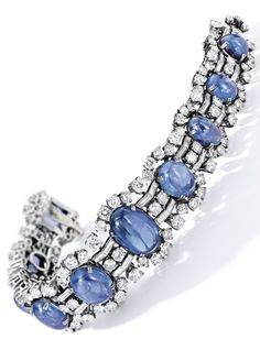 A Vintage Sapphire and Diamond Bracelet, Bulgari, Circa 1955. Set with cabochon sapphires and embellished with circular-cut and baguette diamonds, mounted in platinum, signed. #Bulgari #vintage bracelet
