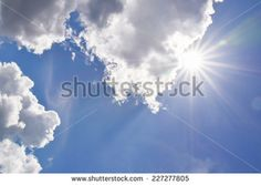 Realistic shining sun with lens flare. Blue sky with clouds