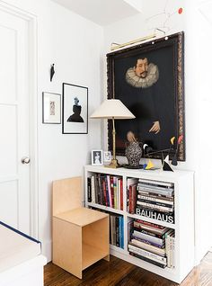 Proof that antique and modern objects can work together: A dark Flemish painting hangs above a chair designed by Donald Judd and alongside a black-and-white photograph of Marilyn Monroe taken by Bert Stern in 1962.