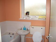 Picturesque Orange Bathroom Design Inspirations 2014 : Impressive Orange Bathroom Design with White Tiles Backsplash and White BuiltIn Bathtub also White Pedestal Sink