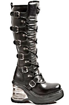 New Rock 8272 Boot Black leather Knee high boot Anatomic insoles 7 adjustable skull buckle straps Inside zip Front lacing Metallic wedge heel Natural rubber soles Hand made construction