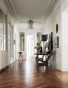 Embrace entryways  Don't forget about the humble hallway. Do as the French do and make it a statement room in itself.  Key pieces: a statement light, a wooden table, fresh flowers
