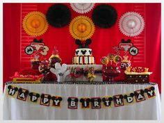 Mickey Mouse Birthday Party Ideas. Cute Mickey Mouse table decoration with Mickey cake and buntings