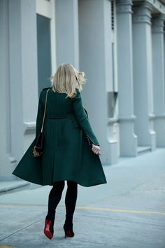 emerald green coat + black opaque tights + black Christian Louboutin ankle boots