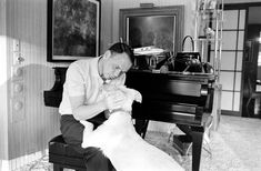 Not published in LIFE. Frank Sinatra and his dog, Ringo, at Sinatra's home in Palm Springs, California, in 1965.