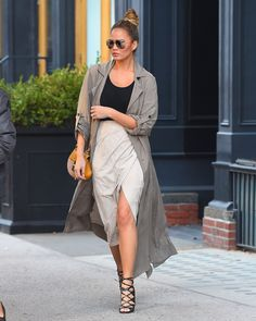 In a sheer duster coat, cream slit skirt and lace-up heels.    - HarpersBAZAAR.com