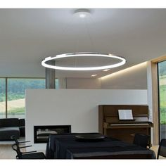 Upgrade a ceiling light with a drum shade with simple parts from the hardware store and a inexpensive drum shade.