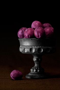 Still Life With Plums by Tom McNemar Love the richness of the plum against the black and the dull sheen on the dish.