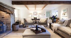 The great lighting at lots of levels brings a slick look to this farmhouse style living room.