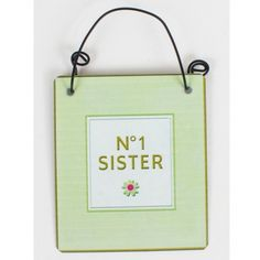 Show your sister just how much she means to you with this gorgeous shabby chic/vintage style hanging metal sign/plaque. It has a light green border with white square insert and flower detail which displays 'No.1 Sister' in the centre. Size = 6cm width x 7cm height approx. Made from metal by Heaven Sends.