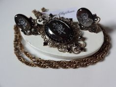 Vintage Reversed Carved Glass Black Flower Pendant Brooch Set.  Beautiful set with pendant that also can be worn as a brooch. Reverse carved black glass, a single Intaglio Rose, featured on clip earri