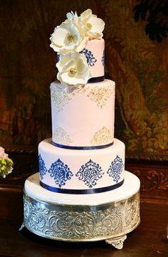 Modern wedding cake idea - three-tier, fondant-frosted wedding cake with blue + gold design and sugar flowers {Thirteenth Moon Photography LLC}
