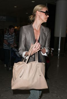 Check out our thorough look at Charlize Theron's personal handbag collection.
