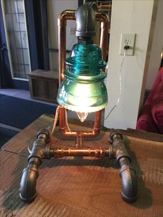 Copper and black pipe light with glass insulator by Keith