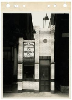 Exterior view of White Castle number 18. Located at 6134 Easton Ave. in St. Louis, Missouri. Opened on May 11, 1928. The building was sold in April of 1939. Photograph was taken by P.R. Papin. White Castle sign reads 5 cent hamburgers.