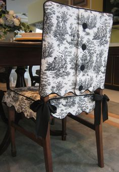 This is my Scalloped Edge Toile Chair Suit® with covered button closure; shown here in black and white toile.  The skirt ties on with coordinated satin ribbon ties.  Both the jacket and skirt are lined.  Each set is custom made to fit your chair.  Available in other colored toiles as well.  Dry clean only.