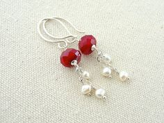 These faceted glass beads are the most beautiful shade of red! They are wire wrapped in sterling silver to handcrafted, artisan ear wires. Below