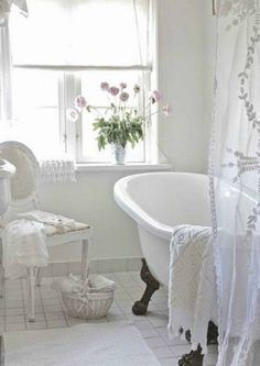 loving this all white bathroom. The sheer shower curtain is beautiful.