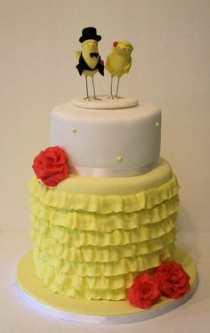 yellow and white bird wedding cake