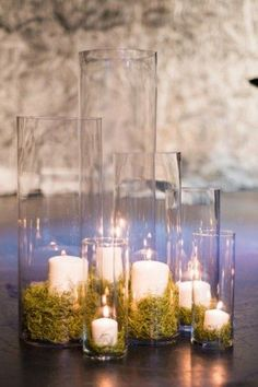 woodland moss and candle wedding decor  / http://www.himisspuff.com/woodland-moss-wedding-ideas/4/
