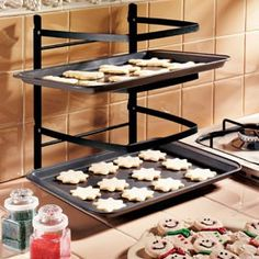 Big-batch baking is easier, even where counter space is scarce. Durable, stackable rack has four tiers to hold just-from-the-oven baking sheets or casserole dishes—folds nearly flat for storage!