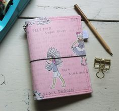 This listing is for one A6 - sized Vintage Children Catdori - fabric Midori-style travelers journal cover to house your notebooks, bible studies, bullet journal or Notebook-style planner inserts.  Beautifully document thoughts and dreams, grocery lists, project plans, weekly and monthly schedules. Appointments, shopping trips, and travel adventures. All while carrying it all in one place.  Your one-of-a-kind Catdori is made of cotton and cotton blend fabrics, the heaviest double sided…
