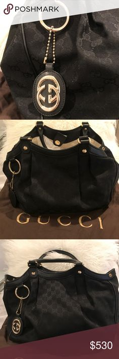 Authentic Gucci Black Sukey Medium tote Excellent condition on exterior of bag the only signs of wear are minor stains in the interior and ink marks.... please see photo. Includes GG leather charm and dust bag.  No wear or tear on exterior of this iconic bag. Gucci Bags Totes