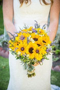 Sunflowers & black eyed susans with purple and white accents ~ we ❤ this! moncheribridals.com