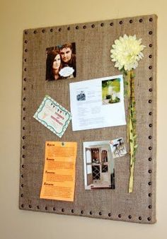 Corkboard covered in burlap with upholstery nails. Looks so classy!