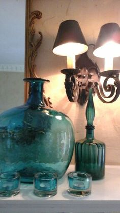 Spring interiors 2015. Working in touches of antique gold throughout...pretty pop colors with vintage glass...here in teal